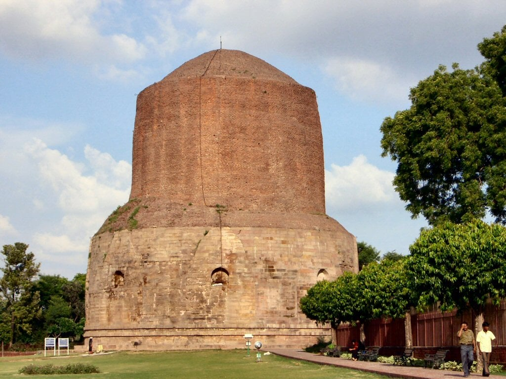 6. Excavated Remains At Sarnath, Uttar Pradesh: International Visitors: 2.1 lakh. Sarnath is a place located 10 kilometers north-east of Varanasi near the confluence of the Ganges and the Varuna rivers in Uttar Pradesh, India. The deer park in Sarnath is where Gautama Buddha first taught the Dharma, and where the Buddhist Sangha came into existence. (Image: WikiCommons)