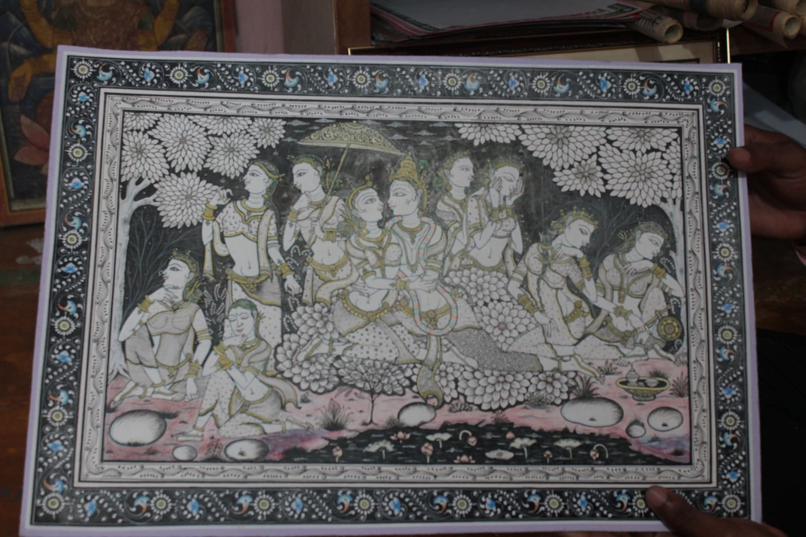 A scene of 'Raas-Leela' painted on canvas. Patachitra, an art form, are paintings on dried palm leaves or on canvas. Artists from a tiny village in the Puri district, Raghurajpur, mostly paint scenes from mythology related to Lord Krishna.