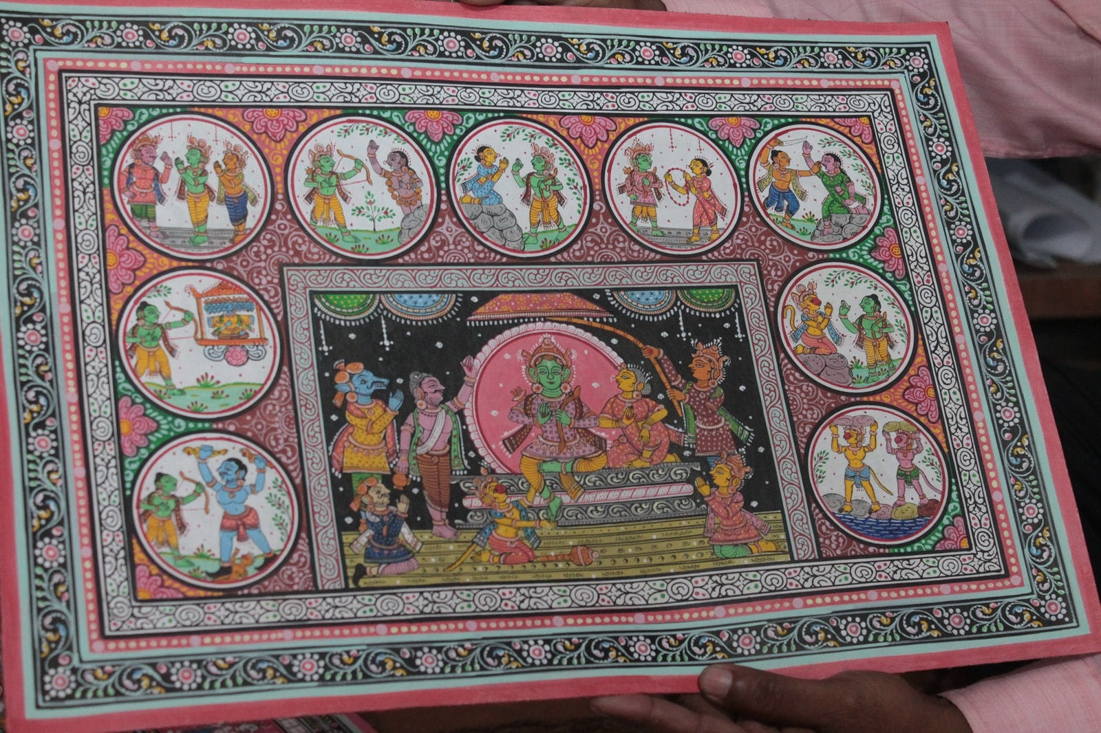 Important scenes from the great epic 'Ramayana' can be seen. Artists take up to two weeks or more to paint one such painting. The intricacies and the size of the image determine the time a painting takes to complete.