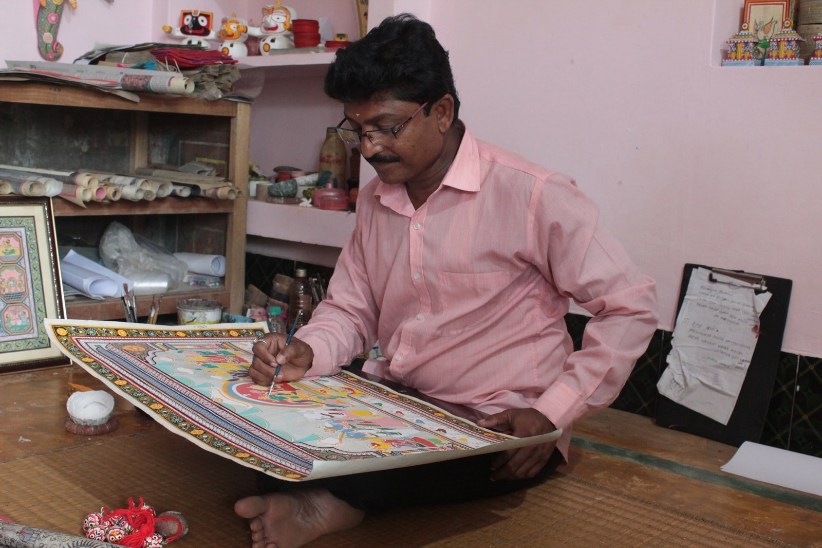 Artist Bhaskar Mahapatra is seen at work. He is painting a scene from the 'Ramayan.'