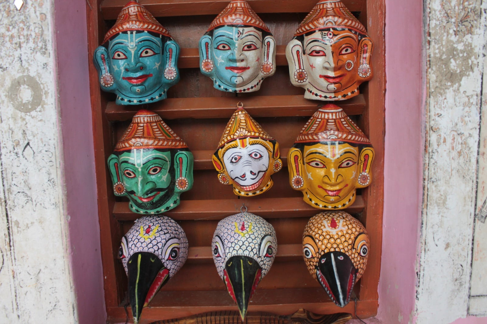 Painted masks on display.