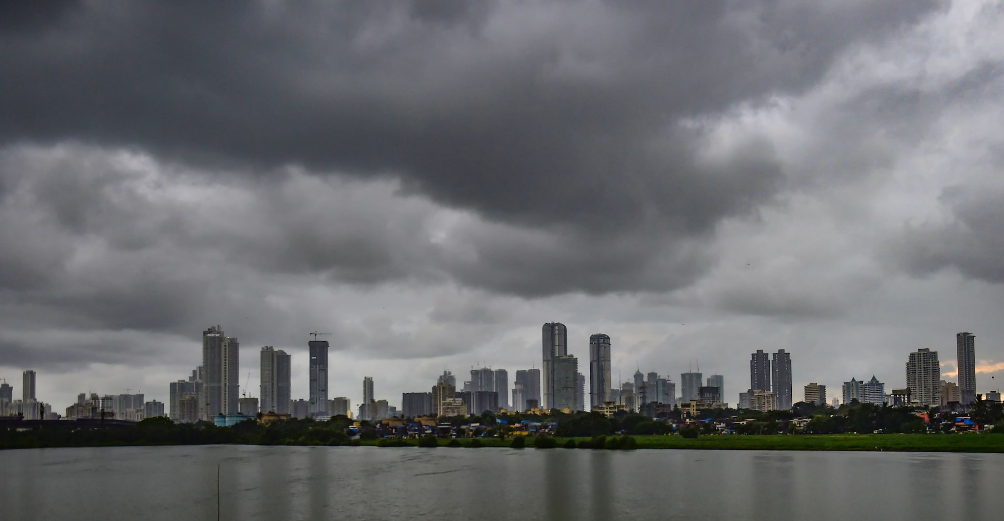 Monsoon clouds gather over the city skyline, in Mumbai on July 23. (PTI Photo/Shashank Parade)