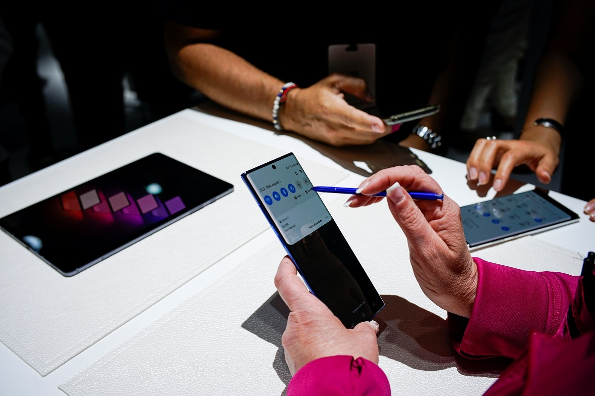 People test new devices during the launch event of the Samsung Galaxy Note 10 at the Barclays Center in Brooklyn. With an emphasis on improved video and photography features, which helped Huawei become the world's Number 2 smartphone vendor, Samsung hopes the Galaxy Note 10 will appeal to YouTubers and fans of social media. (REUTERS/Eduardo Munoz)