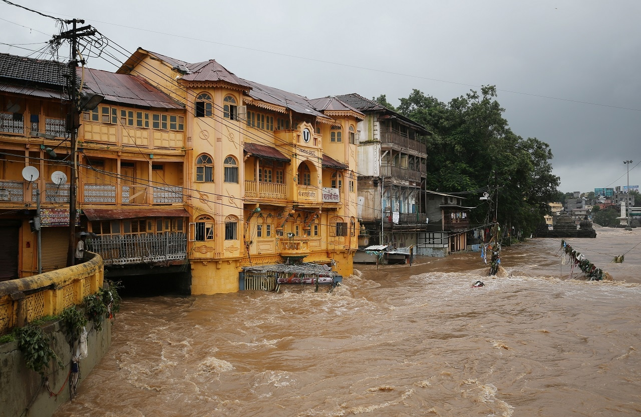 Houses are seen submerged in the waters of overflowing river Godavari after heavy rainfall in Nashik, August 5, 2019. REUTERS/Francis Mascarenhas