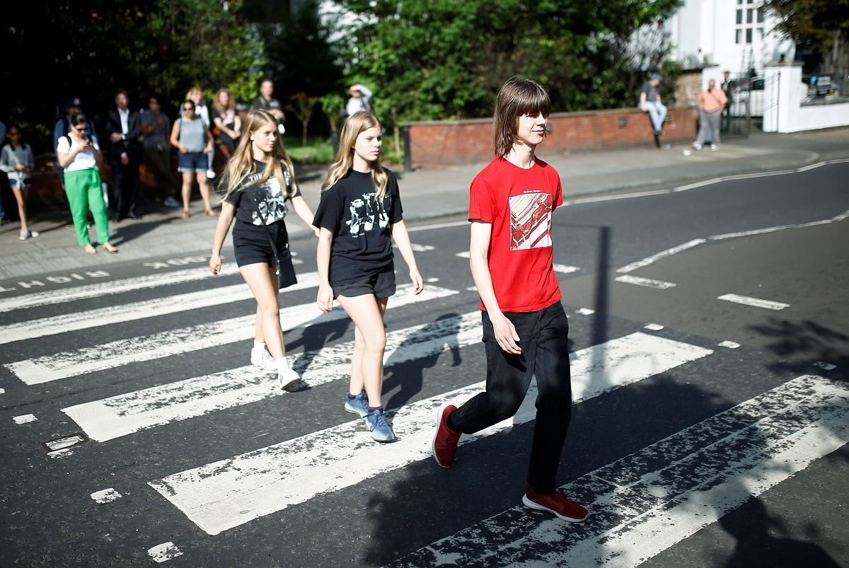 Fans recreate the iconic Beatles photo on Abbey Road in London. The picture of John Lennon, Paul McCartney, George Harrison and Ringo Starr striding over the pedestrian crossing on Abbey Road was taken outside the EMI Recording Studios where they made the 1969 album of the same name. REUTERS/Henry Nicholls