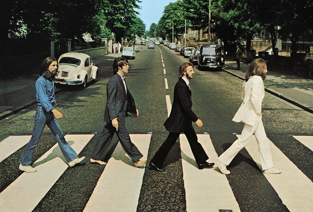 Members of the Beatles, George Harrison, Paul McCartney, Ringo Starr, John Lennon, cross Abbey Road in London, Britain.  Hundreds of people gathered at the world's most famous zebra crossing on Thursday to mark the 50th anniversary of the day the Beatles were photographed on it, creating one of the best-known album covers in music history and an image imitated by countless fans ever since. Iain Macmillan, courtesy Apple Corps/via REUTERS