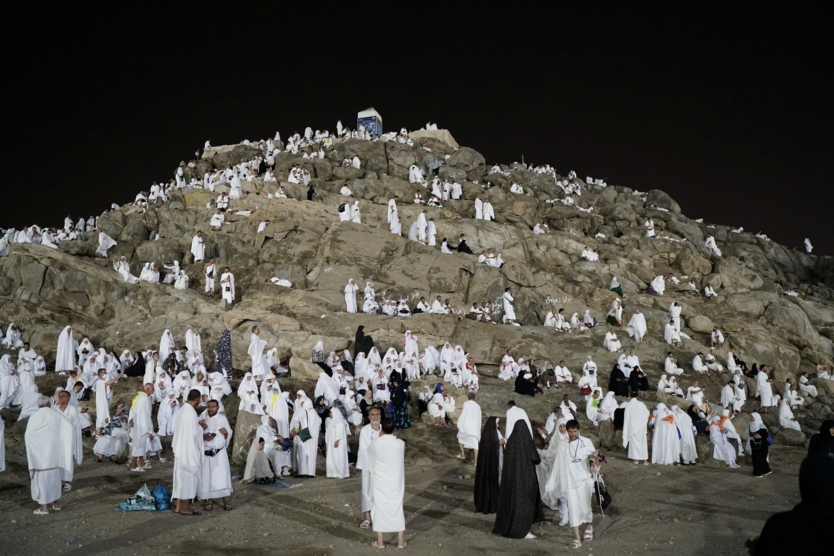Pilgrims clad in white robes signifying a state of purity spent the night in a sprawling encampment around the hill where Islam holds that God tested Abraham's faith by commanding him to sacrifice his son Ismail. It is also where Prophet Mohammad gave his last sermon. REUTERS/Umit Bektas