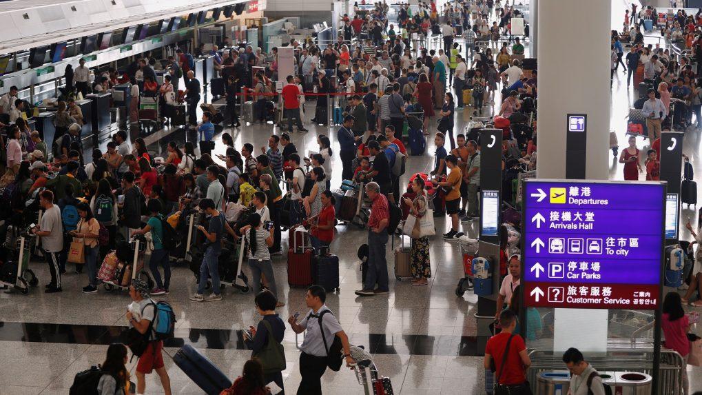 Hong Kong's airport reopens, more than 200 flights cancelled