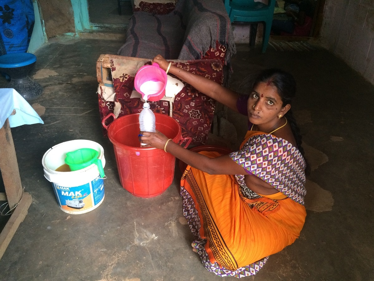 Devi making phenyl and at her home in Nedumalai village in Tamil Nadu. Thomson Reuters Foundation/Anuradha Nagaraj