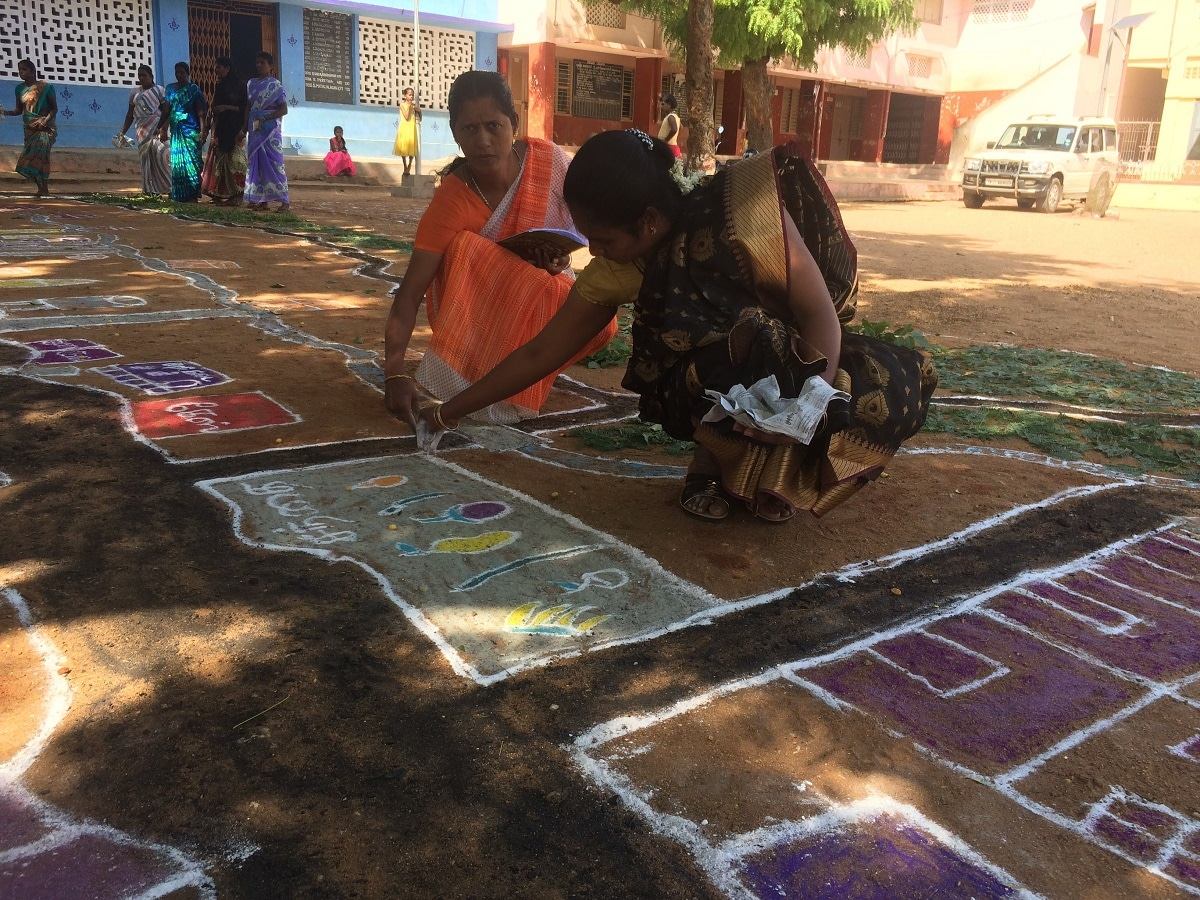 Women drawing a community map using the kolam art form in Ayyampatty. Thomson Reuters Foundation/Anuradha Nagaraj