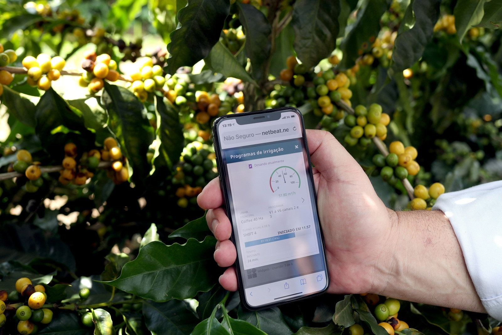 A farmer shows an irrigation management system app on his mobile phone at a coffee plantation in Sao Sebastiao do Paraiso, Brazil April 22, 2019. REUTERS/Amanda Perobelli/Files