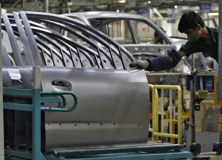 Auto companies in India cut more jobs, halt production to tackle slowdown