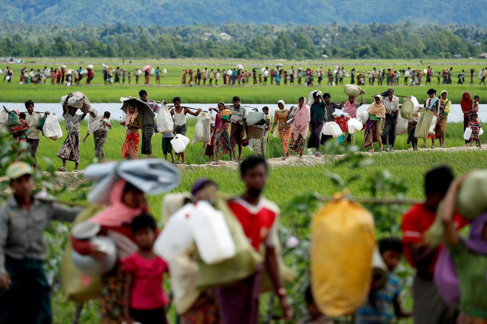 Rohingya refugees, who crossed the border from Myanmar two days before, walk after they received permission from the Bangladeshi army to continue on to the refugee camps, in Palang Khali, near Cox's Bazar, Bangladesh October 19, 2017. REUTERS/Jorge Silva/File Photo
