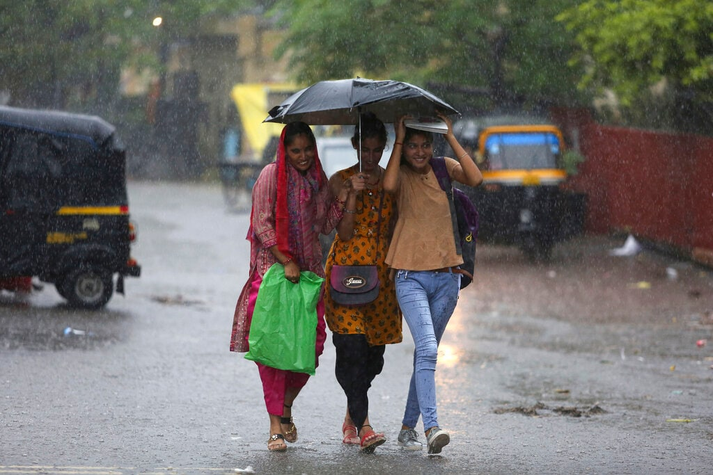 Indian girls walk with an umbrella in the rain in Jammu, India, Saturday, July 27, 2019. The monsoon season in India lasts from June to September. (AP Photo/Channi Anand)