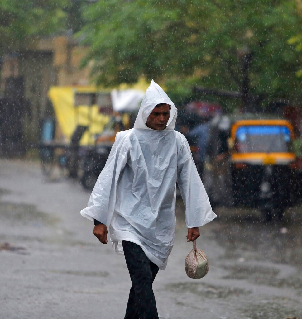 An Indian man walks in the rain in Jammu, India, Saturday, July 27, 2019. The monsoon season in India lasts from June to September. (AP Photo/Channi Anand)