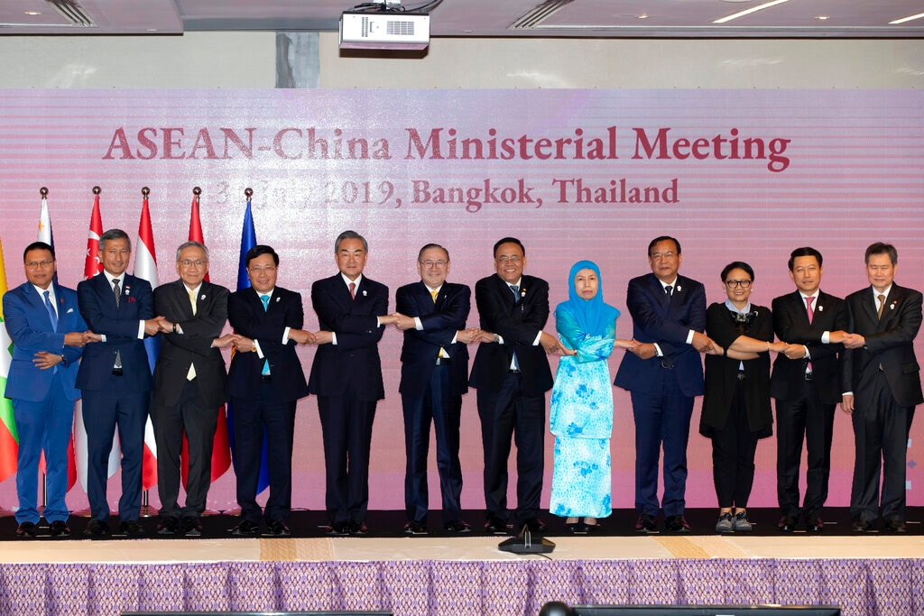 China's Foreign Minister Wang Yi, fifth from left, poses for a group photo during the ASEAN-China Foreign Ministers Meeting in Bangkok, Thailand, Wednesday, July 31, 2019. Southeast Asian foreign ministers opened their annual meeting Wednesday with a call from host Thailand for deeper integration to expand trade and bolster prosperity in the region amid rising global challenges.(AP Photo/Gemunu Amarasinghe)
