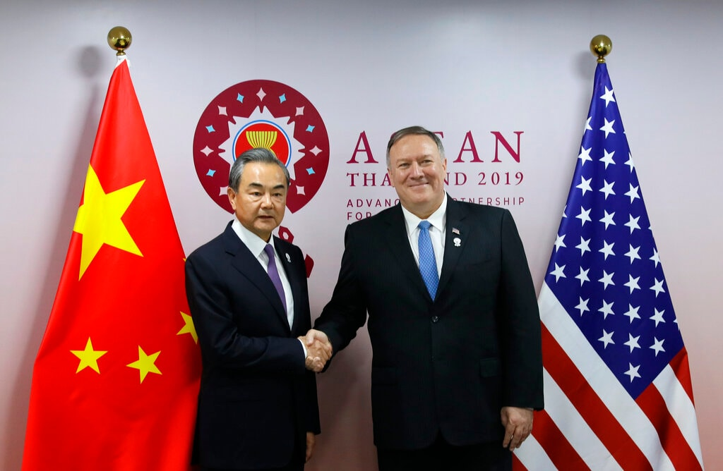 US secretary of state Mike Pompeo, right, shakes hands with Chinese foreign minister Wang Yi on the sidelines of the ASEAN Foreign Ministers' Meeting in Bangkok, Thailand, Thursday, Aug. 1, 2019. (Jonathan Ernst/Pool Photo via AP)