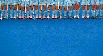 Argentina's hockey players stand during the playing of the national anthems before their women's preliminaries pool WA against Canada, at the Pan American Games in Lima, Peru, Wednesday, July 31, 2019. Argentina went on to win the match 3-0. (AP Photo/Silvia Izquierdo)