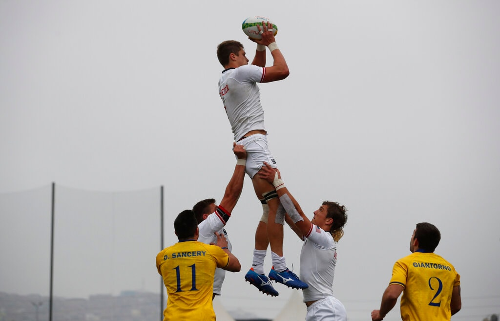 United States' Joe Schroeder is lifted to catch the ball during a rugby seven match against Brazil at the Pan American Games in Lima, Peru, Sunday, July 28, 2019. United States went on to win the bronze. (AP Photo/Moises Castillo)
