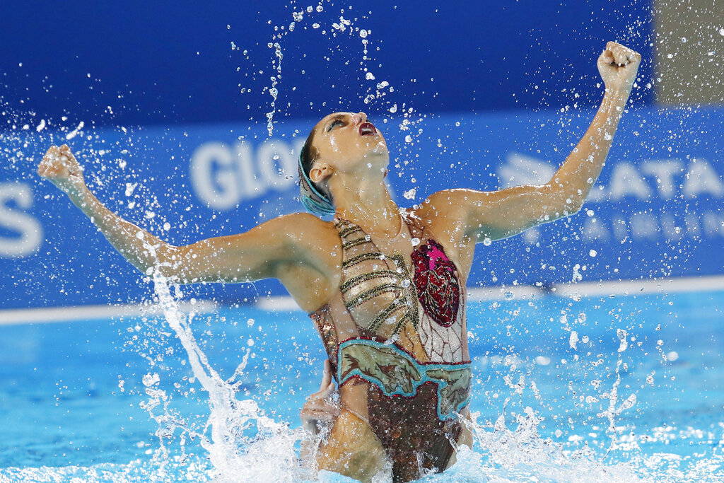 Ruby Remati of the United States competes in the artistic swimming duet technical routine final at the Pan American Games in Lima, Peru, Wednesday, July 31, 2019. Remati and teammate Anita Alvarez went on to win a bronze medal. (AP Photo/Moises Castillo)