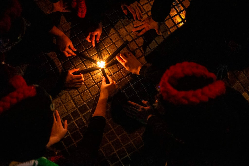 Women light candles during a march in favor of feminist movements, against racism and calling on state authorities to expand legal abortion rights in Santiago, Chile, Thursday, July 25, 2019. The event took place marking International Day of Afro-Latin American and Afro-Caribbean Women. (AP Photo/Esteban Felix)