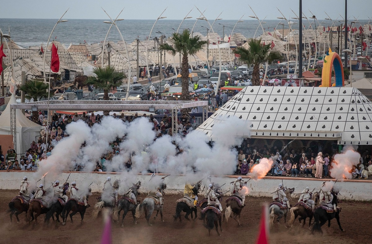 A troupe charges and fires their rifles during Tabourida in the coastal town of El Jadida, Morocco. (AP Photo/Mosa'ab Elshamy)