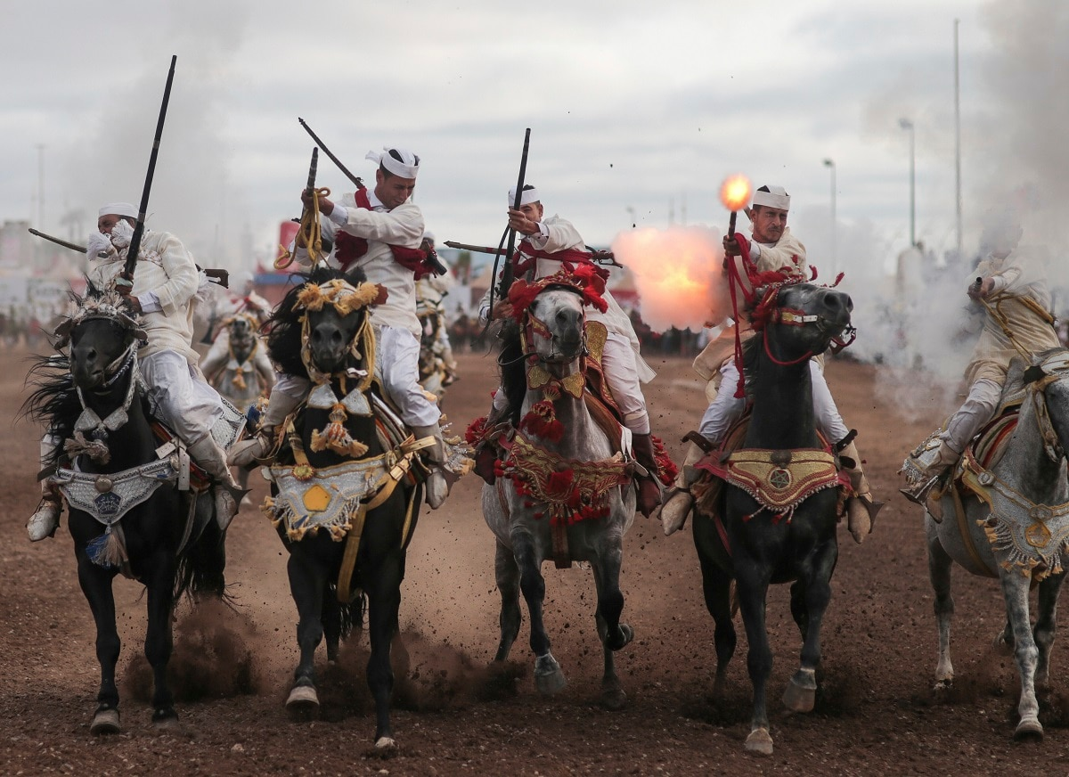 Thousands of visitors descend on the Moroccan coastal city of El Jadida each July to attend the largest equestrian show in the kingdom _ a breathtaking horseback performance that combines synchronized riding with decorative guns. (AP Photo/Mosa'ab Elshamy)