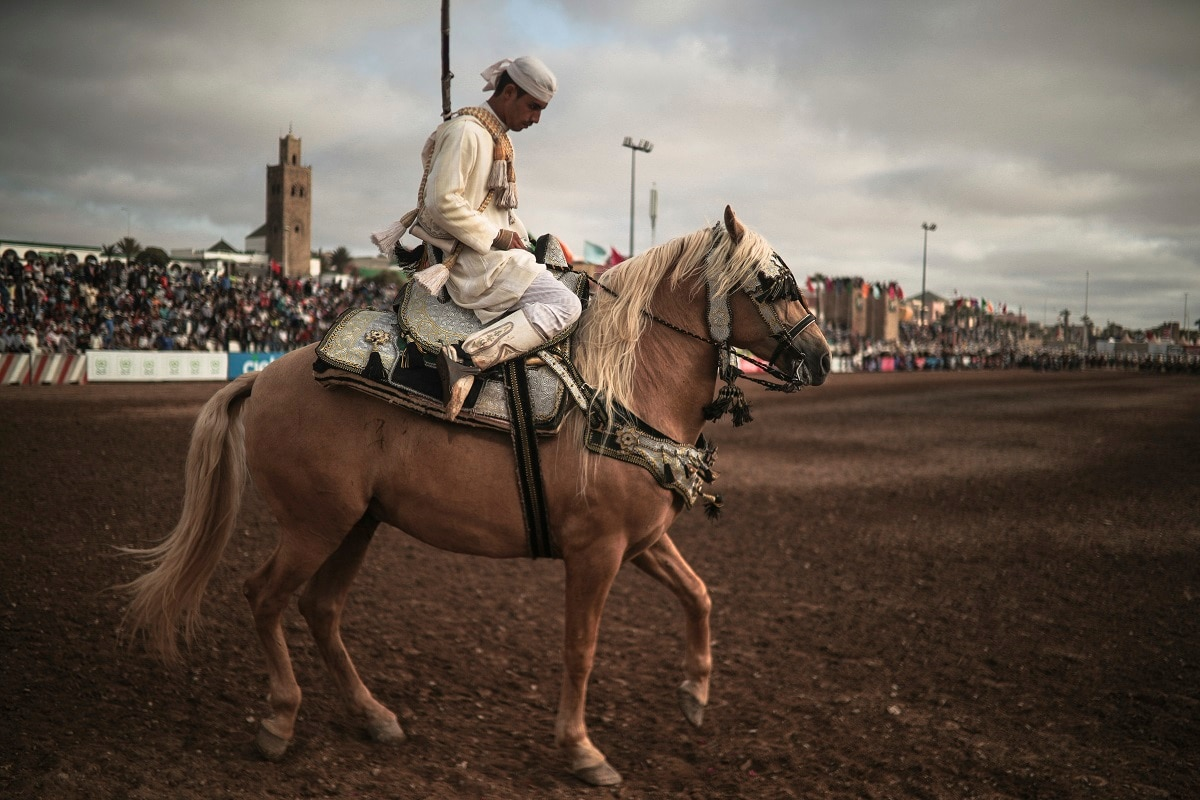 A horse rider prepares to exit after his troupe took part in Tabourida. (AP Photo/Mosa'ab Elshamy)