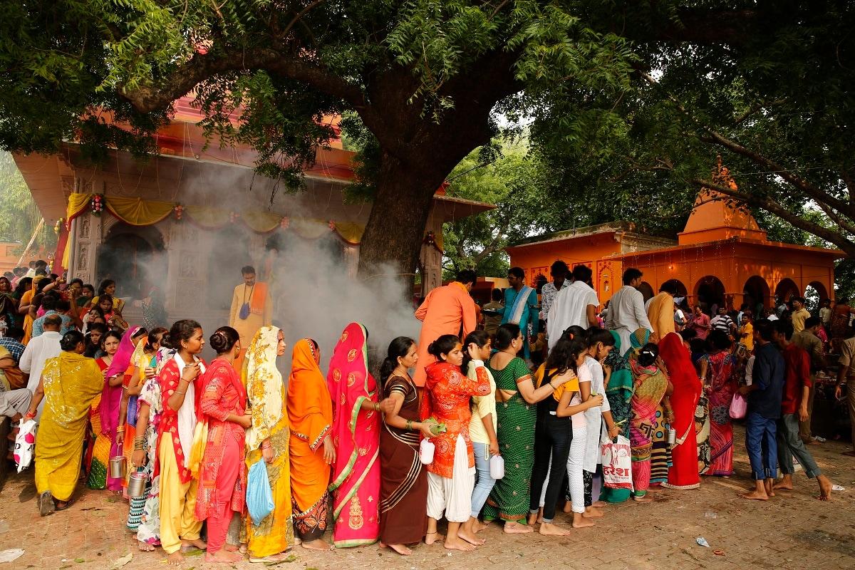 Hindu devotees queue up to offer prayers at the Nag Vasuki Temple during the annual Nag Panchami festival, in Prayagraj. (AP Photo/Rajesh Kumar Singh)