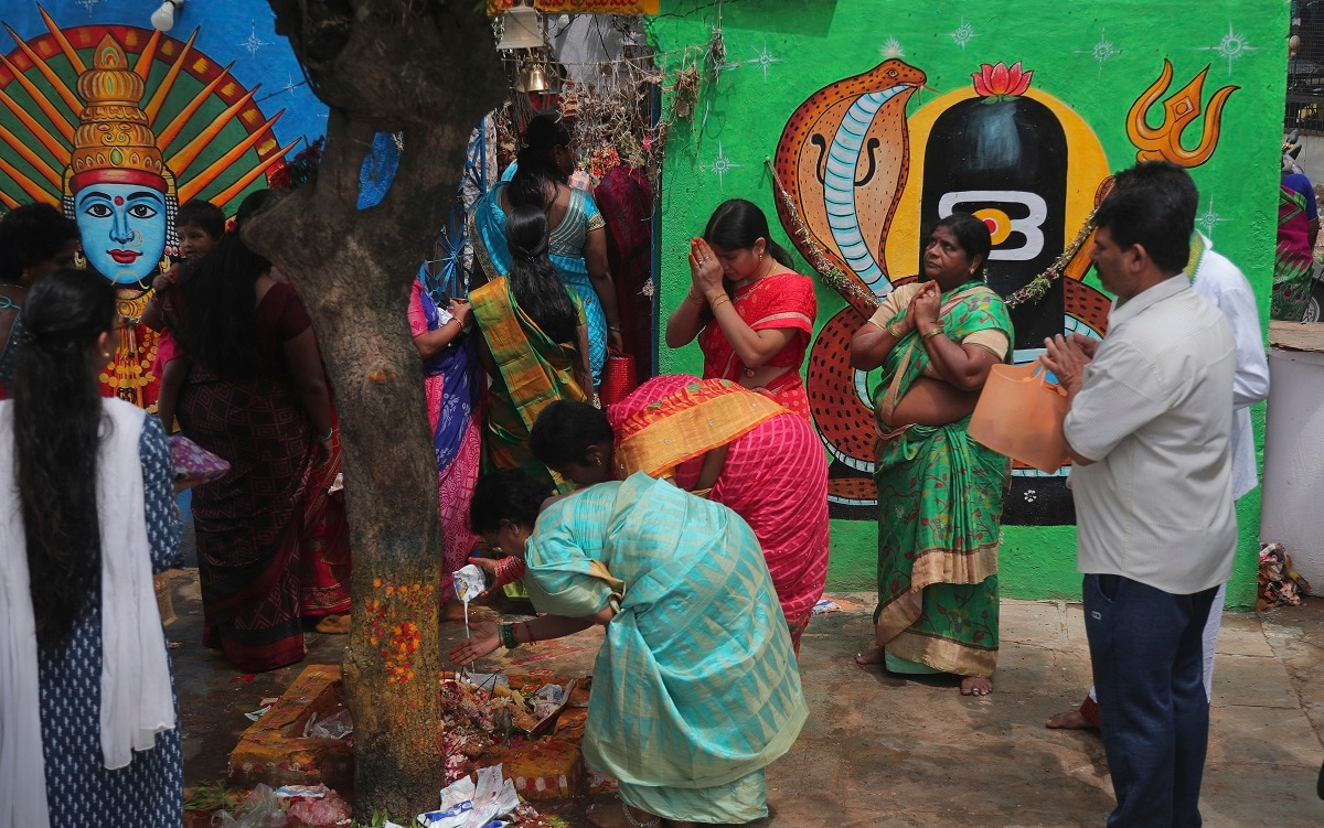 Devotees offer prayers at a snake temple during Nag Panchami festival in Hyderabad. (AP Photo/Mahesh Kumar A.)