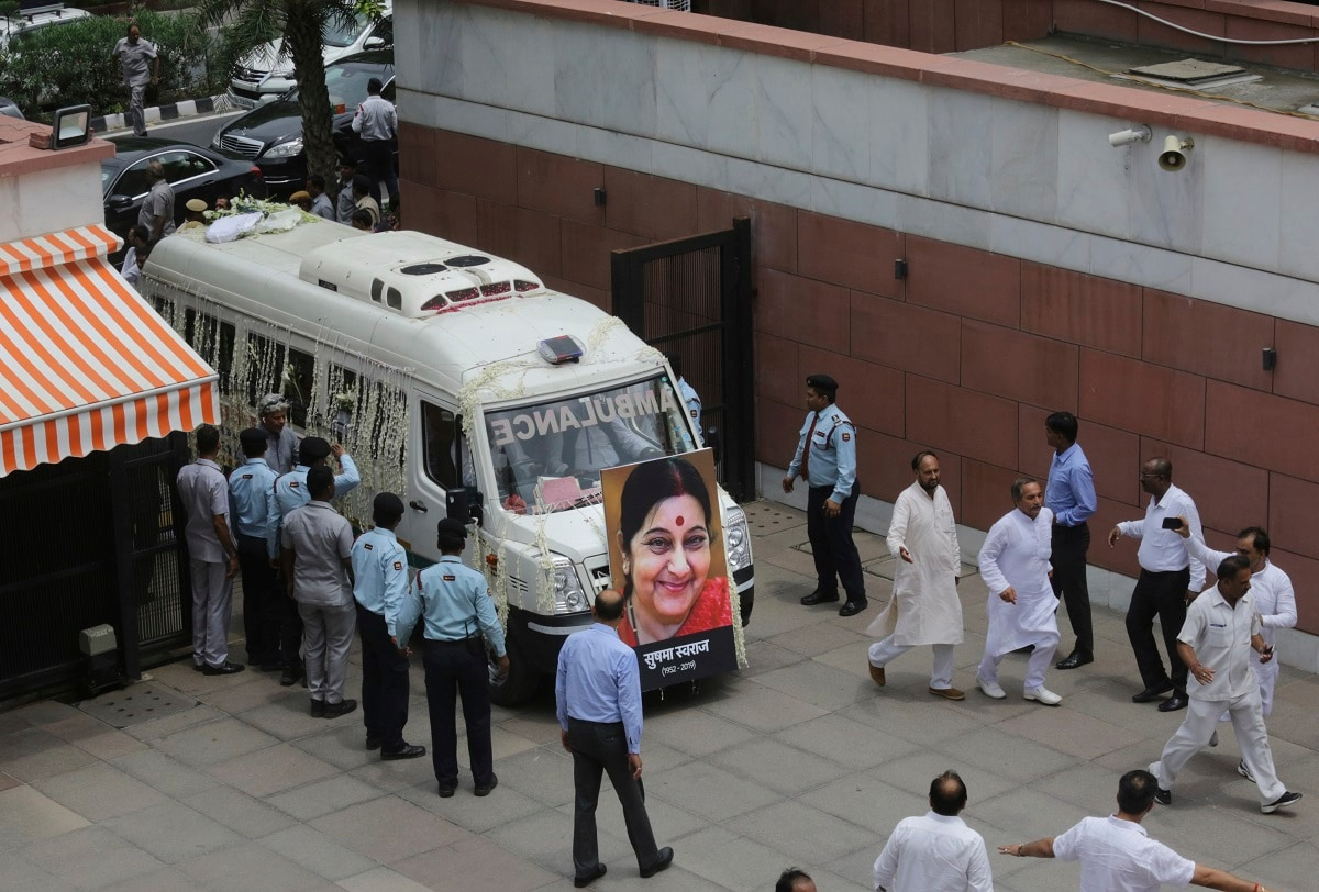 The body of former Indian Foreign Minister Sushma Swaraj is brought to the Bharatiya Janata Party headquarters in New Delhi. (AP Photo/Manish Swarup)