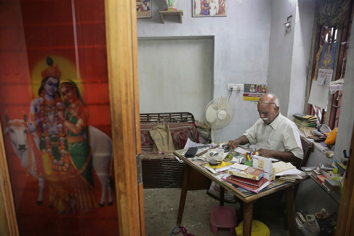 Retired civil servant R Devarajan works on his desk in his three-floor house equipped with rainwater harvesting system in Chennai. (AP Photo/Manish Swarup)