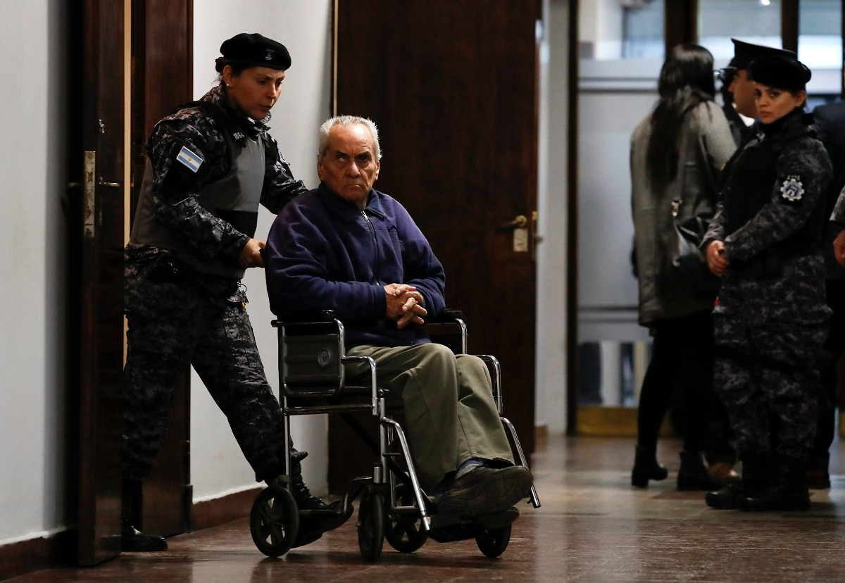 Rev. Nicola Corradi is escorted from the courtroom after attending the first day of his trial for alleged crimes against deaf minors in Mendoza, Argentina. The alleged abuse took place between 2004 and 2016, and the case gained world attention when it emerged that Corradi had faced similar accusations at the Antonio Próvolo institute in Verona, Italy, and Pope Francis had been notified the Italian priest was running a similar centre in Argentina. (AP Photo/Natacha Pisarenko)