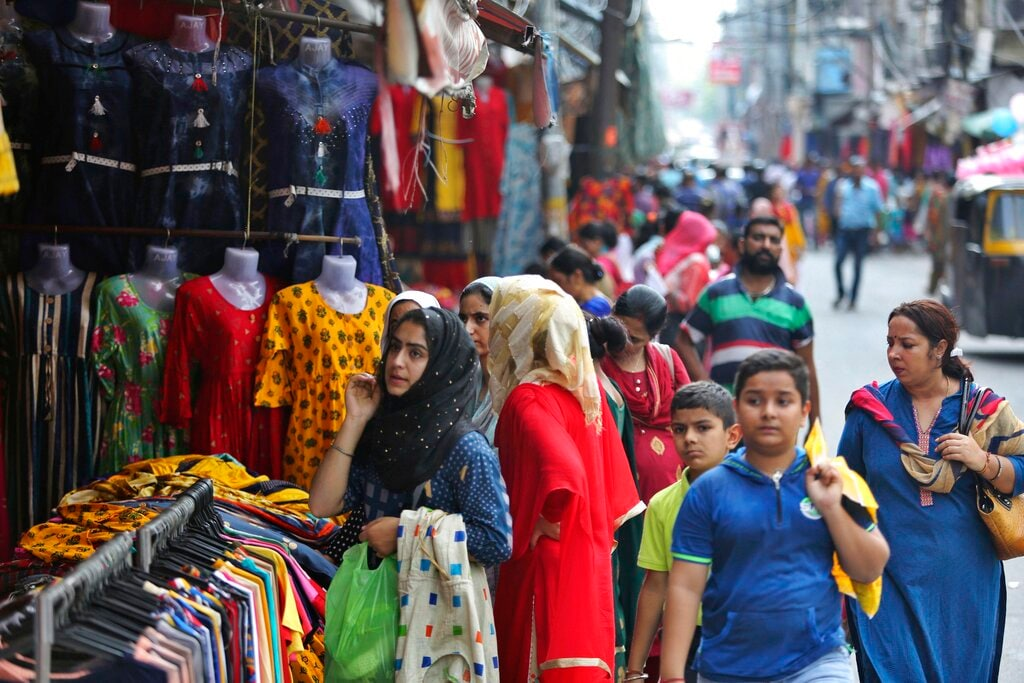 People shop at a market on the eve of Eid al Adha, in Jammu, India, Sunday, Aug.11, 2019. (AP Photo/Channi Anand)