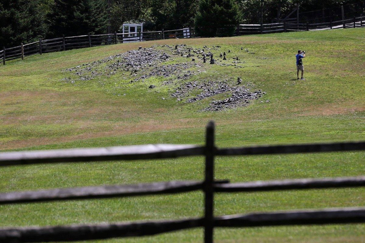A flat piece of ground and some rocks are all that remain of the stage of the 1969 Woodstock Music and Arts Fair. (AP Photo/Seth Wenig)