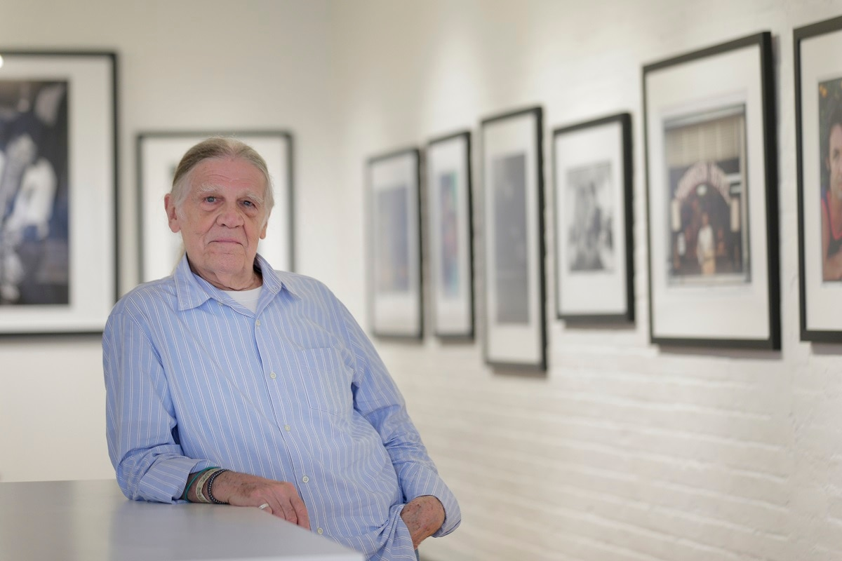 Henry Diltz poses for a picture in the Morrison Hotel Gallery in New York. Diltz said he got to the site early during the setup: