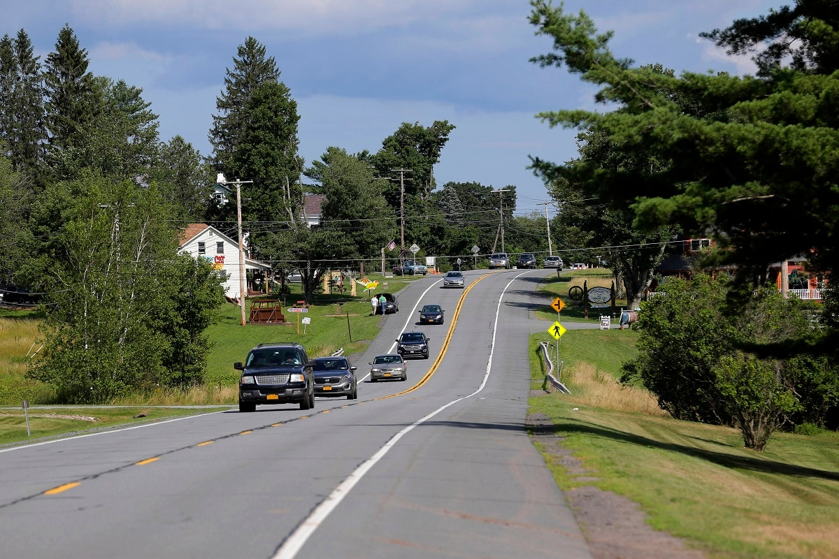 Vehicles head west on route 17B, near the site of the 1969 Woodstock Music and Art Festival in Bethel. It was a great spot for peaceful vibes, but miserable for handling the hordes coming in by car. (AP Photo/Seth Wenig)
