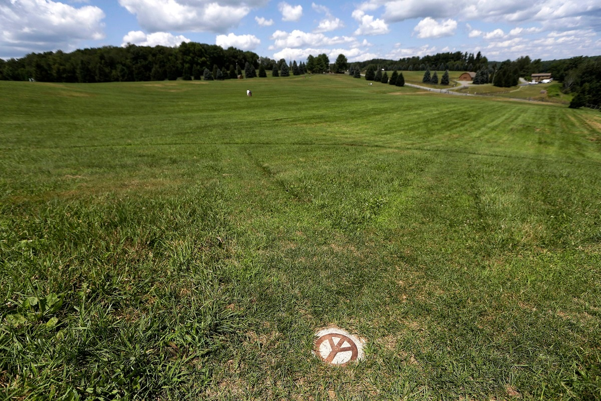 A small peace sign is set into the grass at the site of the 1969 Woodstock Music and Arts Fair, in Bethel. (AP Photo/Seth Wenig)