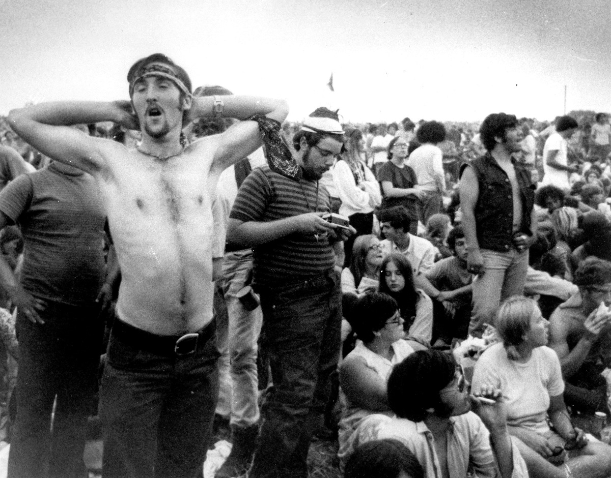 Fans relax during a break in the entertainment at the Woodstock Music and Arts Fair in Bethel. (AP Photo/File)