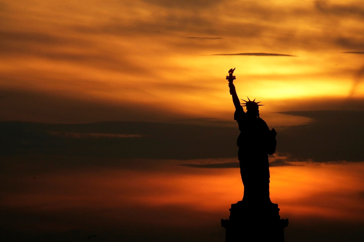 The Statue of Liberty stands at sunset in New York. (AP Photo/Seth Wenig, File)