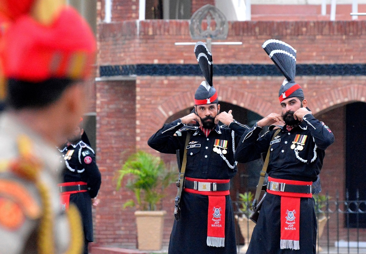 Pakistan Rangers soldiers face Indian Border Security Force soldiers at a daily closing ceremony on the Indian side of the Attari-Wagah border.  (AP Photo/Prabhjot Gill)