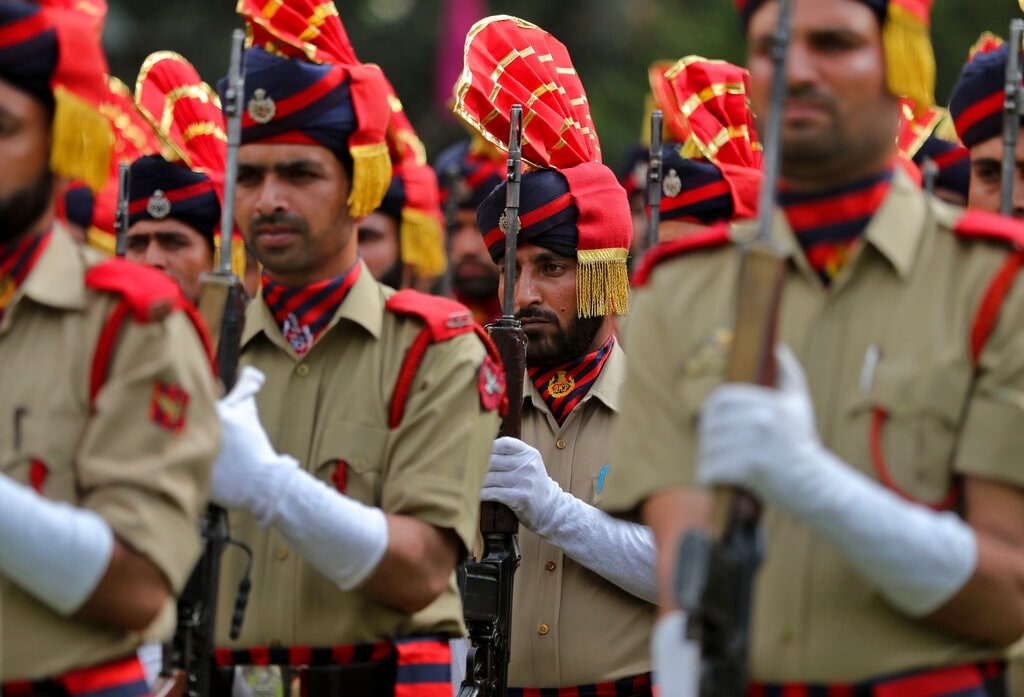 Jammu and Kashmir police personnel participate in India's Independence Day parade in Srinagar, Indian controlled Kashmir, Thursday, Aug. 15, 2019. Indian Prime Minister Narendra Modi defended his government's controversial measure to strip the disputed Kashmir region of its statehood and special constitutional provisions in an Independence Day speech Thursday, as about 7 million Kashmiris stayed indoors for the 11th day of an unprecedented security lockdown and communications blackout. (AP Photo/Mukhtar Khan)