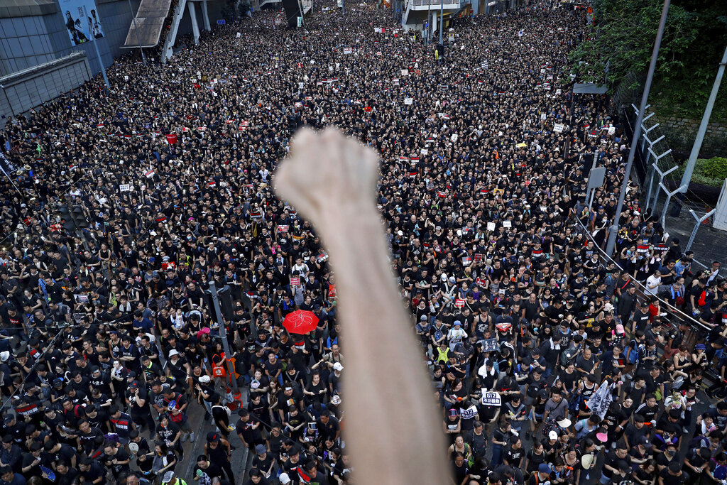 Protesters march on the streets against an extradition bill in Hong Kong. June 16, 2019. (AP Photo/Vincent Yu, File)