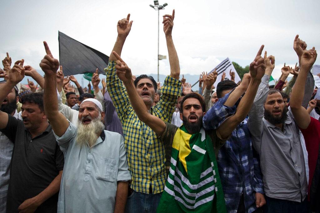 Kashmiris shout pro-freedom slogans during a demonstration on August 16. (AP Photo/Dar Yasin)