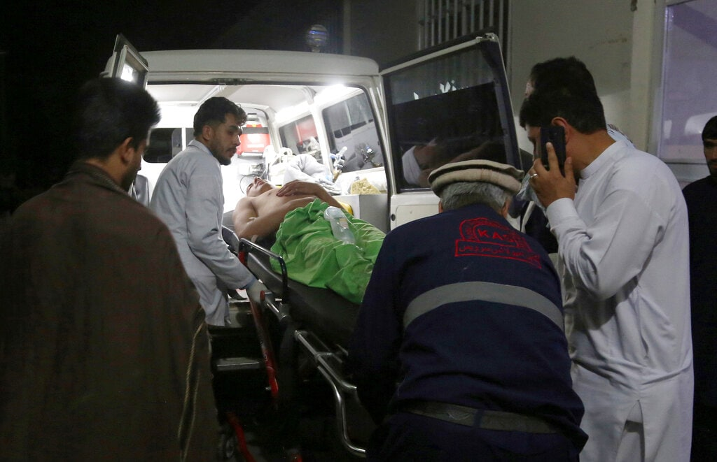 A wounded man is carried to a hospital after an explosion at a wedding hall in Kabul, Afghanistan, Sunday, Aug.18, 2019. (AP Photo/Nishanuddin Khan)
