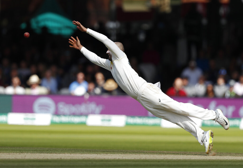 Australia's Nathan Lyon dives but fails to catch the ball from England's Jos Buttler during play on day five of the 2nd Ashes Test cricket match between England and Australia at Lord's cricket ground in London, Sunday, Aug. 18, 2019. (AP Photo/Alastair Grant)