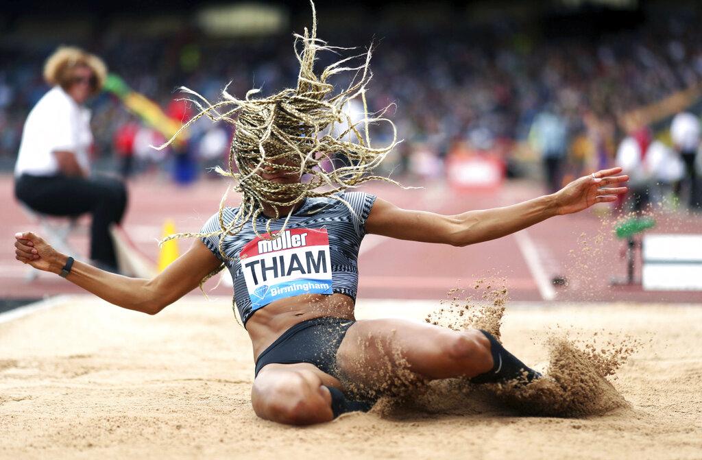 Belgium's Nafissatou Thiam takes part in the Women's Long Jump, during the Muller Grand Prix, Diamond League Birmingham 2019 event at the Alexander Stadium, in Birmingham, England, Sunday, Aug. 18, 2019. (David Davies/PA via AP)