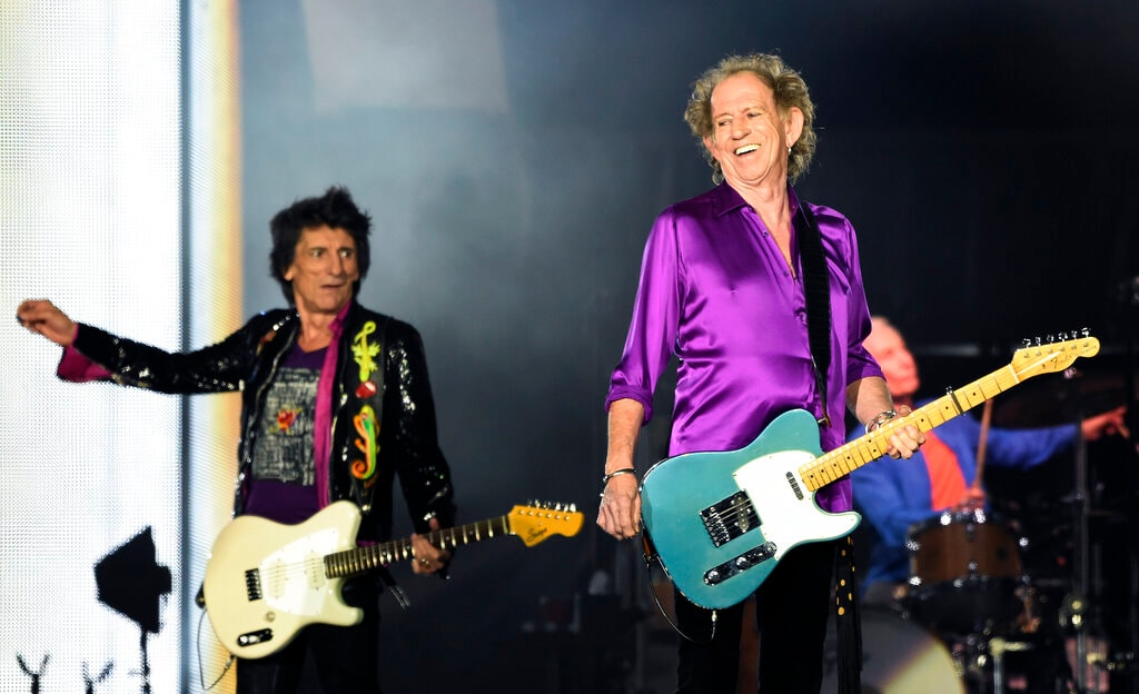 Ron Wood, left, and Keith Richards of the Rolling Stones perform during their concert at the Rose Bowl, Thursday, Aug. 22, 2019, in Pasadena, Calif. (Photo by Chris Pizzello/Invision/AP)