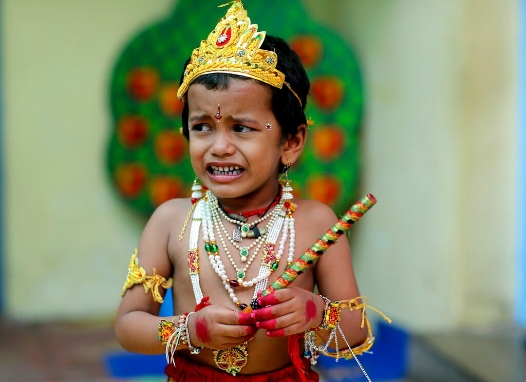 In this Friday, Aug. 23, 2019, file photo, an Indian school child dressed as lord Krishna cries while participating in a costume contest on the eve of Krishna Janmashthami festival, the birth anniversary of Hindu God Krishna, in Hyderabad, India. (AP Photo/Mahesh Kumar A, File)