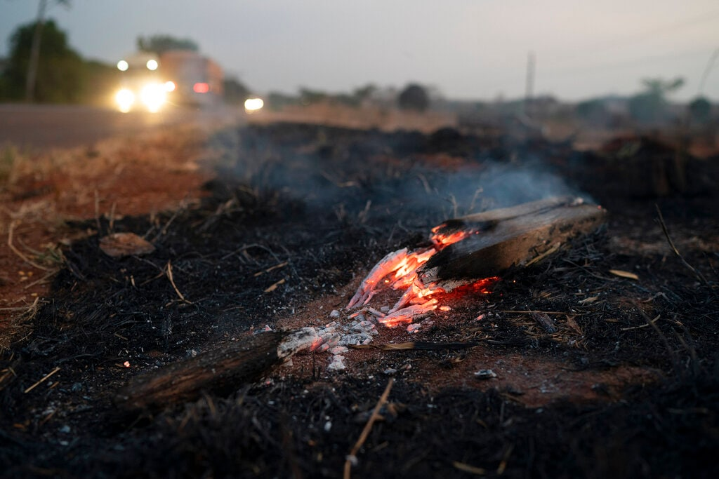 Embers from a wildfire smolder along BR 163 highway in the Nova Santa Helena municipality, in the state of Mato Grosso, Brazil, Friday, Aug. 23, 2019. (AP Photo/Leo Correa)